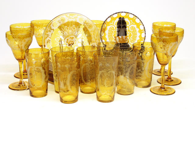 A Bohemian amber flashed cut to clear glass part table suite early 20th century