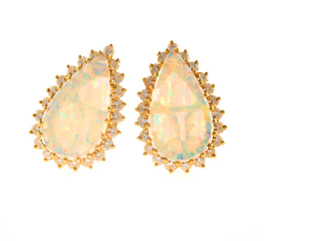 A pair of opal and diamond earclips