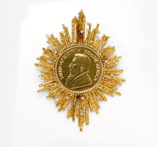 A gold Kuggerand coin in diamond and 18k gold pendant surround