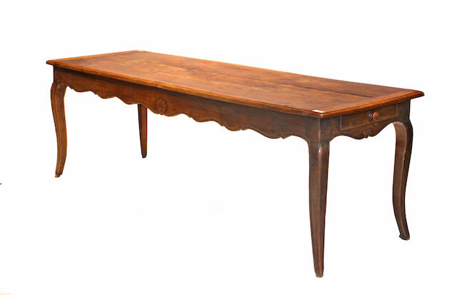A Louis XV style walnut refectory table, incorporating antique elements