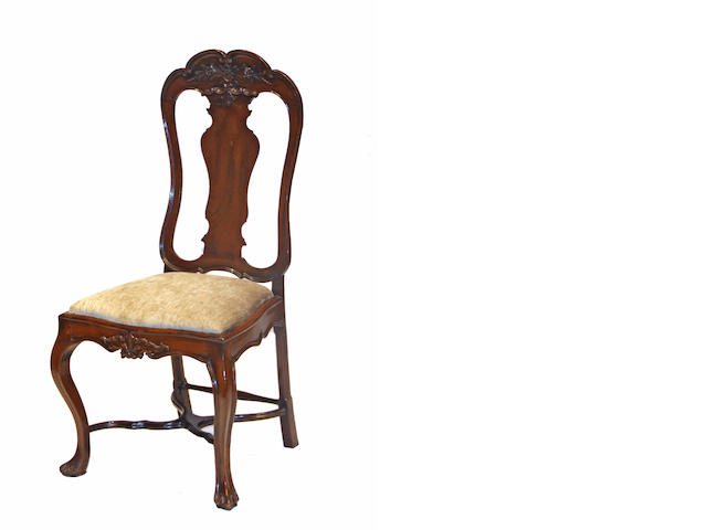 A pair of Continental Rococo style walnut side chairs 19th century