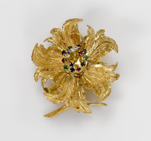 A ruby, sapphire, emerald, diamond and 18k gold articulated flower brooch