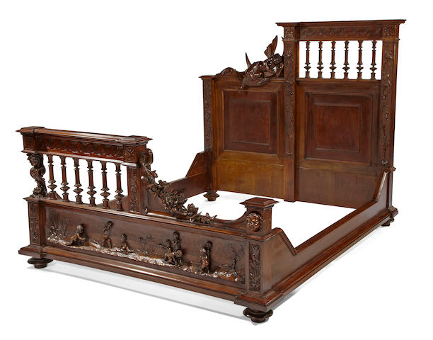 A Florentine Renaisannce style carved walnut bedroom suite<BR />attributed to Luigi Frullini<BR />third quarter 19th century