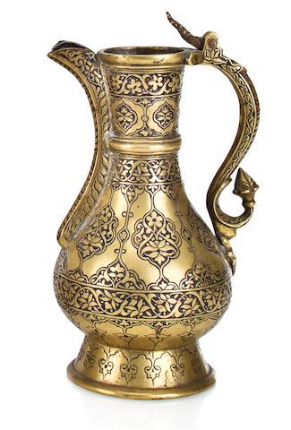 A brass lidded Jug  Deccan, dated 1591