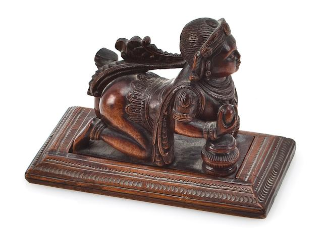 A wood figure of the Krishna as the butter thief Mysore, 19th century