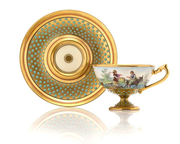 "A Dresden ""jeweled"" porcelain footed cup and saucer circa 1900"
