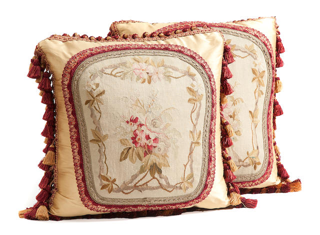 A pair of Aubusson tapestry fragment and silk scatter cushions