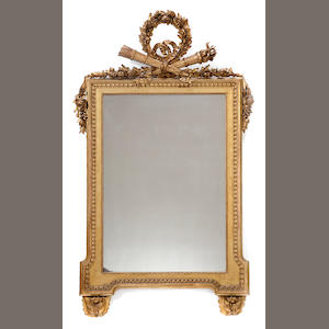 A Louis XVI style carved giltwood mirror . late 19th century