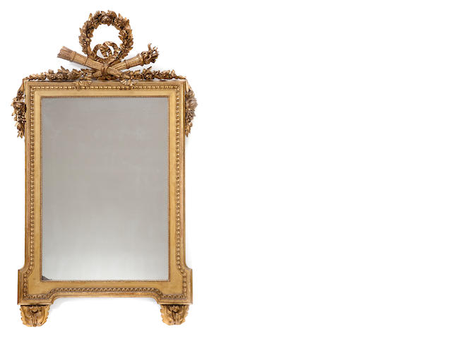 A Louis XVI style carved giltwood mirror <BR />late 19th century