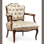 A louis XV style walnut fauteuil with tufted upholstery <BR />late 19th century