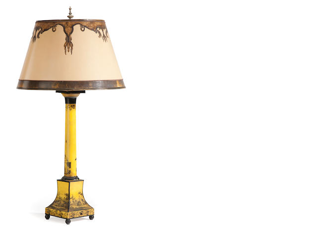A yellow ground tôle table lamp