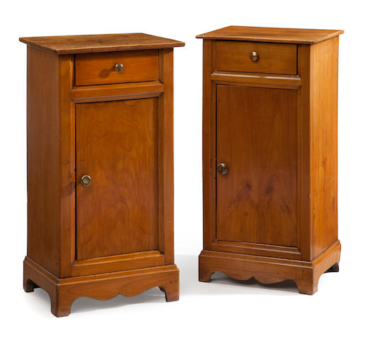 A pair of Continental Neoclassical style walnut bedside commodes  <BR />incorporating antique and later elements