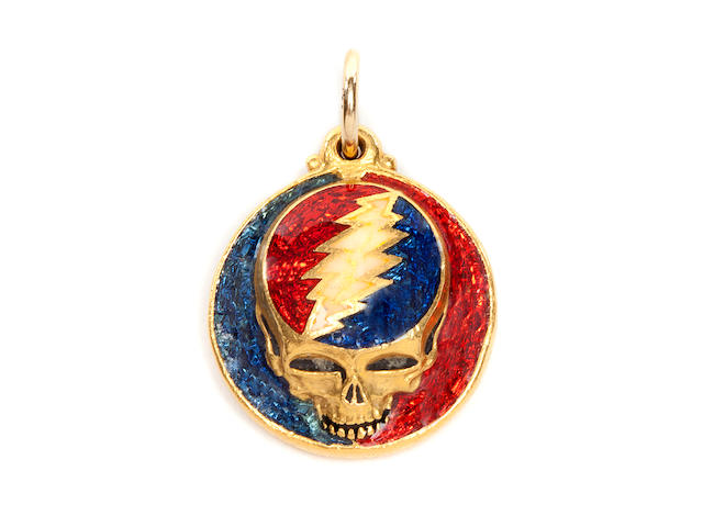 "A circular .9999 gold and enamel ""Steal Your Face"" pendant, made by Owsley ""Bear"" Stanley, A ""Steal Your Face"" pendant, ca. 1979"