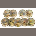 A set of nine Limoges porcelain bird plates <BR />first quarter 20th century