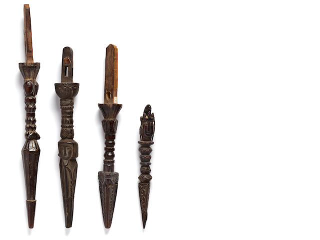 A wooden ritual dagger and three wooden ritual drum handles   Tibet and Nepal 17th/18th century