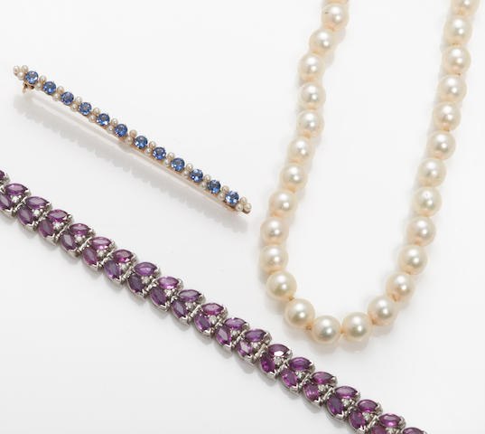 A miscellaneous collection of jewelry including a ruby, diamond and 14k white gold bracelet, a pearl necklace, and a sapphire, pearl and 14k white gold brooch with original box