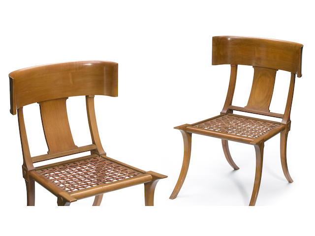 A pair of T.H. Robsjohn-Gibbings for Saridis of Athens walnut and leather Klismos chairs designed 1961