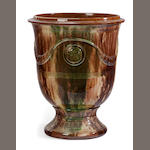 A Glazed terracotta jardinière with relief decoration <BR />modern