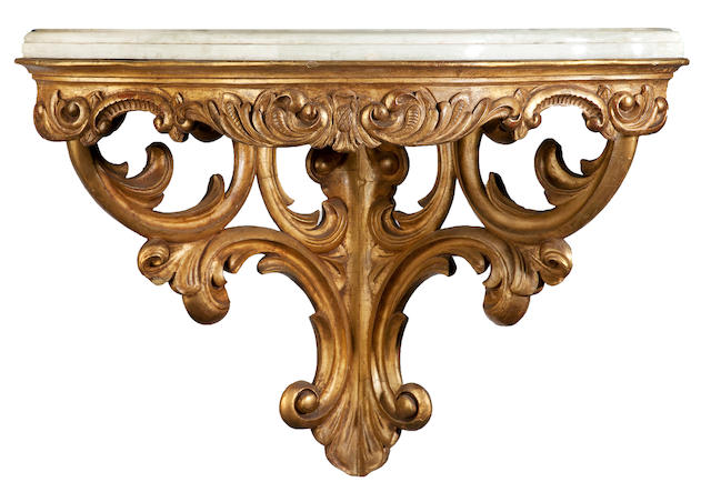 A Continental Rococo style carved giltwood corner console <BR />late 19th century