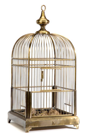 A brass hanging bird cage