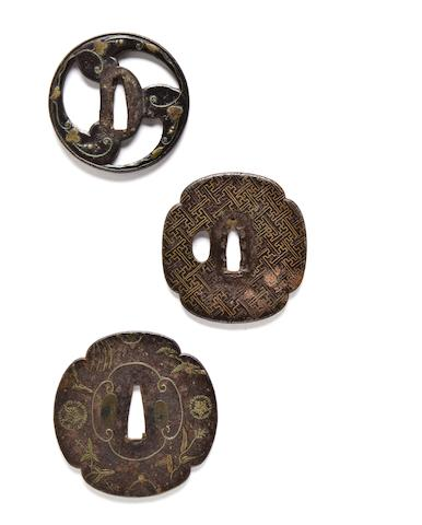 Three brass-inlaid iron tsuba 17th-18th century