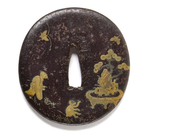 A brass-inlaid iron tsuba By Nagayoshi, 16th century