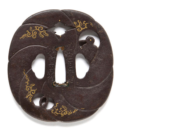An Umetada school small iron tsuba By Umetada Shigeyoshi, 19th century