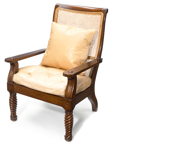 A Continental hardwood and carved panel plantation chair with leather seats
