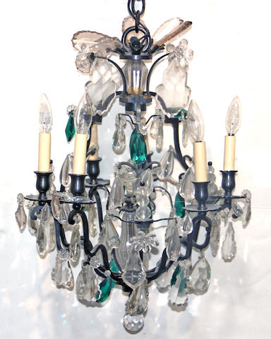 An Italian Rococo style patinated iron, clear and colored glass chandelier second half 20th century