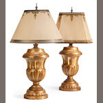 A pair of Neoclassical style giltwood table lamps of fluted urn form <BR />20th century