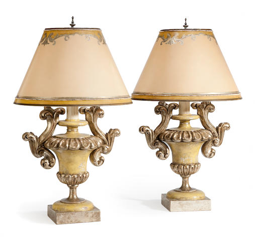 A pair of Italian Baroque style parcel silvered and paint decorated urn form table lamps <BR />20th century