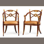 A pair of Neoclassical style parcel gilt and paint decorated armchairs <BR />20th century