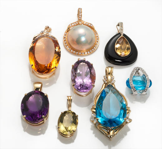 A collection of eight gem-set, black onyx, mabé cultured pearl, diamond and 14k gold pendants and pendant/enhancers