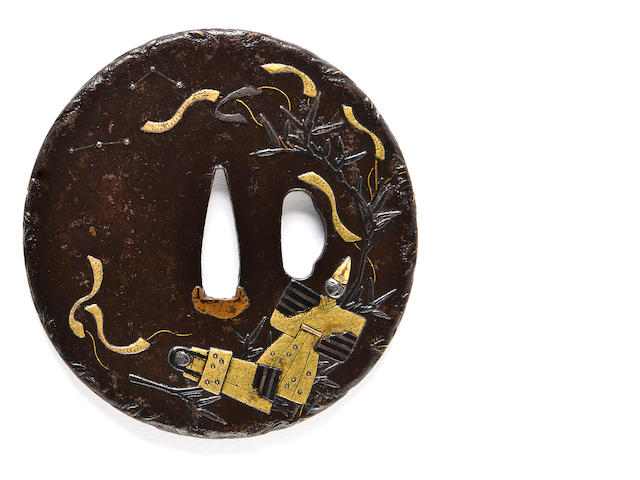 An inlaid iron tsuba 19th century