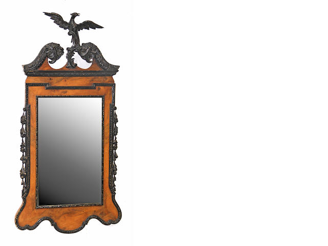 A George II style partial ebonized walnut mirror 20th century