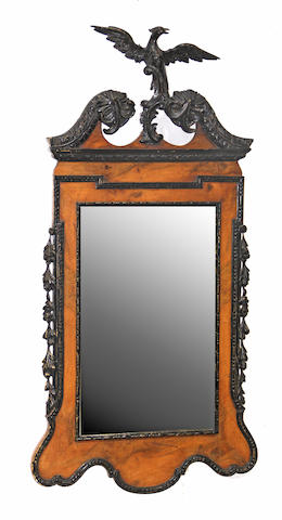 A George II style parcel ebonized walnut mirror 20th century