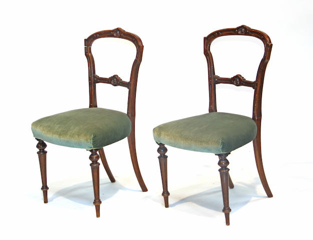 A pair of Victorian walnut side chairs