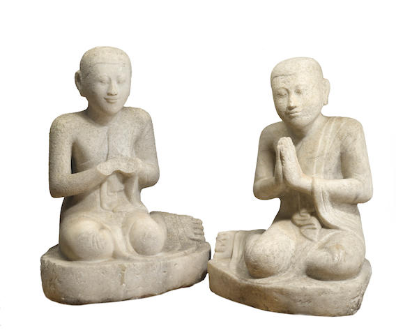A group of two Burmese carved marble figures of seated priests 19th/20th century