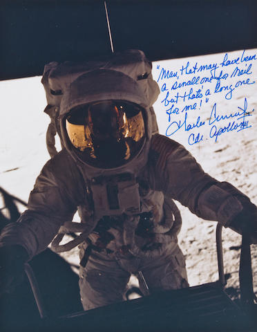 """PETE"" CONRAD'S ONE LONG STEP. Color photograph, 10 x 8 inches. Depicts Apollo 12 Commander Charles ""Pete"" Conrad as he begins his descent down the LM ladder to the lunar surface.  Taken by Alan Bean while still inside the LM."