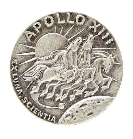 HAISE'S APOLLO 13-FLOWN ROBBINS MEDALLION. Flown Apollo 13 Robbins medallion made from sterling silver, 1½ inches in diameter.