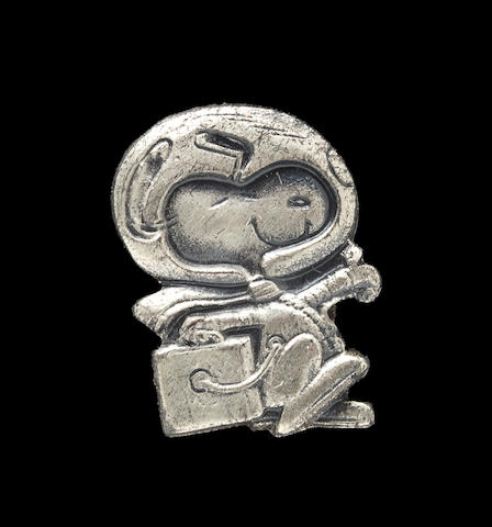 SNOOPY LAPEL PIN CARRIED ON APOLLO 13. Flown Snoopy Lapel Pin made of sterling silver, approximately ½ inch tall.
