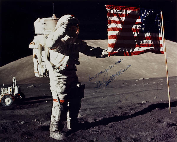 LAST MAN SALUTES THE LAST STARS AND STRIPES. Large color photograph,