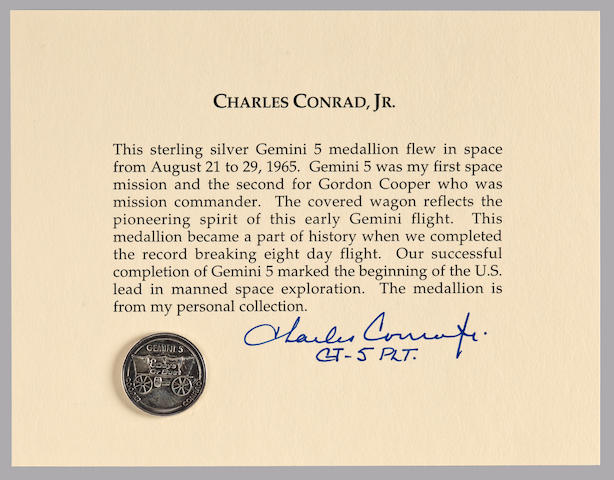 CHARLES CONRAD'S MEDALLION FLOWN ON GEMINI 5. EIGHT DAYS OR BUST—U.S. LEADS SPACE EXPLORATION.
