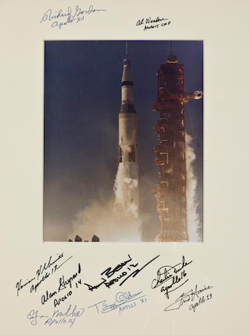 SIGNED BY NINE WHO FLEW THE MOON ROCKET. INCLUDING SHEPARD—THE ONLY MERCURY MOONWALKER.