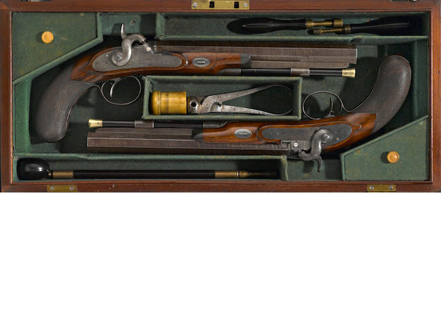 A cased pair of percussion conversion duelling pistols by James Purdey & Sons