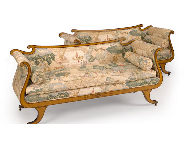 A pair of Regency style satinwood and purpleheart settees<BR />20th century