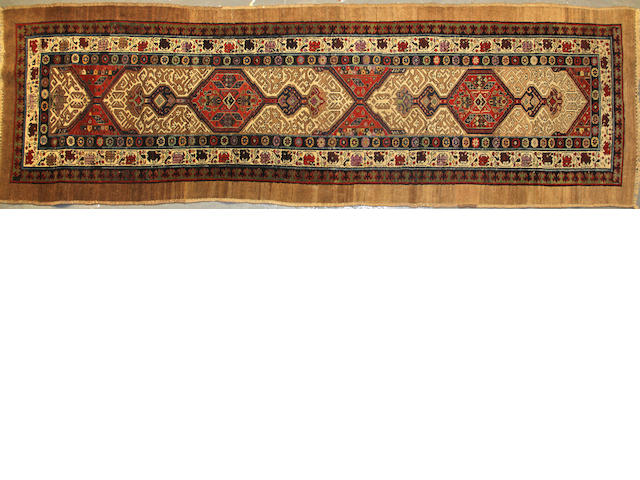 A Serab runner size approximately 3ft. 7in. x 11ft. 8in.