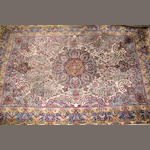 A Kerman carpet size approximately 10ft. 11in. x 17ft. 1in.