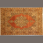 A Tabriz rug size approximately 4ft. x 5ft. 8in.