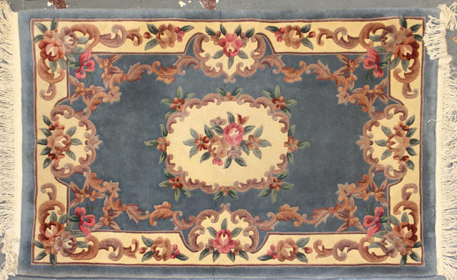 A Chinese rug size approximately 3ft. 10in. x 6ft.